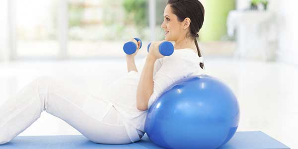 Woman Exercise Ball Dumbbells Exercise